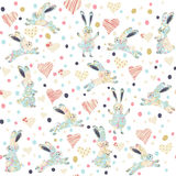 Seamless pattern with cartoon funny rabits Stock Images