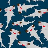 Seamless pattern Cartoon gray Smooth hammerhead Winghead shark Kawaii with pink cheeks and winking eyes positive smiling on dark b. Lue background. Vector Stock Photography