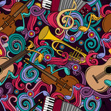 Seamless pattern with Cartoon hand-drawn doodles Musical instruments illustration. Royalty Free Stock Photo