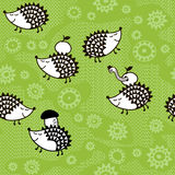 Seamless pattern with cartoon hedgehogs.Kids  background. Stock Image