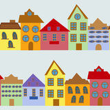 Seamless pattern with cartoon houses Royalty Free Stock Images