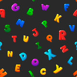 Seamless pattern cartoon kids alphabet bubble. Letters  on black background Stock Photography