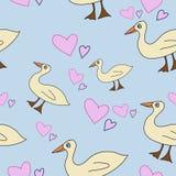 Seamless pattern with cartoony ducks. Cute seamless pattern for kids with ducks and hearts on blue bakground Stock Photography