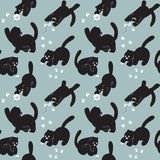 Seamless pattern with cats play. Stock Images