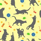 Seamless pattern with cats player. Cats and toys in flat style on yellow background. Vector illustration. Royalty Free Stock Image