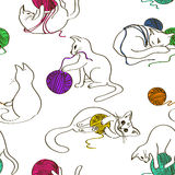 Seamless pattern with cats playing ball of yarn Royalty Free Stock Photo