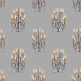 Seamless pattern of the chandeliers with candles Stock Images