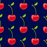 Seamless pattern with cherry on dark blue background Royalty Free Stock Photography