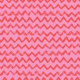 Seamless pattern. Chevron, a zigzag ornament in pink, red colors. Pritn for textiles, wallpapers, scrapbooking in doodle style. stock image