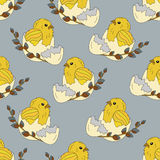 Seamless pattern with chickens in the egg shell and a sprig of willow Royalty Free Stock Image