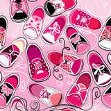 Seamless pattern - children gumshoes on pink backg Stock Photos