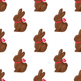 Seamless Pattern Chocolate Bunny with Pink Ribbon. Seamless pattern of chocolate bunny with pink ribbon on white background. Vector illustration of endless Stock Illustration