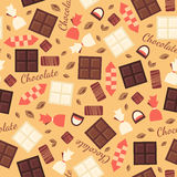 Seamless pattern with chocolate sweets isolated on beige background. Royalty Free Stock Photography