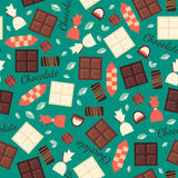 Seamless pattern with chocolate sweets isolated on green background. Royalty Free Stock Image