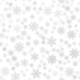 Seamless pattern. Christmas abstract background made of snowflakes on white. Design postcards, posters, greeting for the new year. Stock Photography