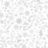 Seamless pattern. Christmas abstract background made of snowflakes on white. Design postcards, posters, greeting for the new year. Vector illustration Stock Photo