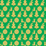Seamless pattern with Christmas bell with holly, a ball, a tree, stocking with snowflakes. Flat elements in shades of gold on the Royalty Free Stock Images
