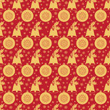 Seamless pattern with Christmas bell  holly leaves and berries, a ball  snowflakes. Royalty Free Stock Photography