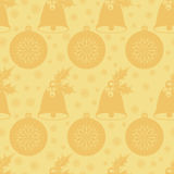 Seamless pattern with Christmas bell with holly leaves and berries, a ball and snowflakes. Flat elements in shades of gold. Vector Royalty Free Stock Images