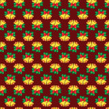 Seamless pattern of Christmas bells with green leaves Stock Photos