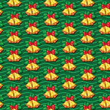 Seamless pattern of Christmas bells with leaves on background wi Stock Image