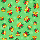 Seamless pattern of Christmas bells with leaves on green backgro Royalty Free Stock Photo