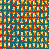 Seamless pattern of Christmas bells with red bows Stock Photography