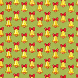 Seamless pattern of Christmas bells with red bows Royalty Free Stock Images