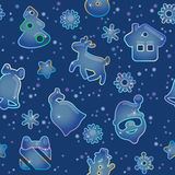Seamless pattern for Christmas on blue background. Pattern from Christmas symbols and snowflakes like icy figures Royalty Free Stock Photography