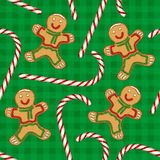 Seamless Pattern. Candy Cane and Gingerbread. Seamless Pattern with Christmas Candy Cane and Gingerbread Man on a Green Plaid Background Stock Photos