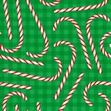 Seamless Pattern with Christmas Candy Cane. On a Green Plaid Background Stock Image