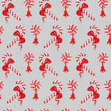 Seamless pattern of Christmas Candy Cane and lollipop. Seamless pattern of Christmas Candy Cane and lollipop with red bow on grey background Royalty Free Stock Photos