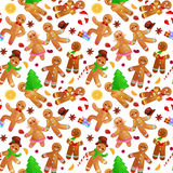 Seamless pattern christmas cookies gingerbread man and girl decorated with icing dancing and having fun Royalty Free Stock Images