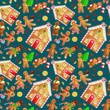 Seamless pattern christmas cookies gingerbread man and girl near sweet house decorated with icing dancing and having fun Stock Images