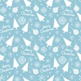 Seamless pattern of christmas elements. On a blue background Royalty Free Stock Photo