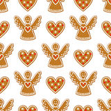 Seamless pattern with Christmas gingerbread cookies - angel and sweet heart. Winter holiday vector design illustration on white background Stock Images