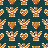 Seamless pattern with Christmas gingerbread cookies - angels and sweet hearts. Winter holiday vector design illustration on dark background Stock Images