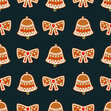 Seamless pattern with Christmas gingerbread cookies - bell and bow. Stock Images
