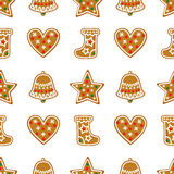 Seamless pattern with Christmas gingerbread cookies - bell, xmas stocking, star, heart. Stock Photo