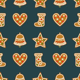 Seamless pattern with Christmas gingerbread cookies - bell, Xmas stocking, star, heart. Royalty Free Stock Photo