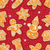Seamless pattern of Christmas gingerbread cookies. Seamless pattern formed by glazed homemade Christmas gingerbread cookies on red background, cartoon vector Stock Image