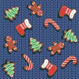 Seamless pattern. Christmas gingerbread cookies on a knitted background. A wool blanket. Christmas treat. Festive royalty free illustration