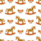 Seamless pattern with Christmas gingerbread cookies - rocking horse and bow. Winter holiday vector design illustration on white background Stock Photo