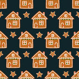 Seamless pattern with Christmas gingerbread cookies - xmas star and cute house. Royalty Free Stock Photos