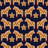 Seamless pattern with Christmas gingerbread cookies - xmas star and horse. Stock Photos