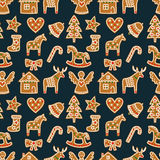 Seamless pattern with Christmas gingerbread cookies - xmas tree, candy cane, angel, bell, sock, gingerbread men, star, heart, deer. Rocking horse. Winter Stock Photos