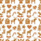 Seamless pattern with Christmas gingerbread cookies - Xmas tree, candy cane, angel, bell, sock, gingerbread men, star, heart, deer. Rocking horse.Winter Royalty Free Stock Images
