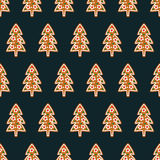 Seamless pattern with Christmas gingerbread cookies - xmas tree. Royalty Free Stock Photo