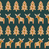 Seamless pattern with Christmas gingerbread cookies - Xmas tree and deer. Royalty Free Stock Photo
