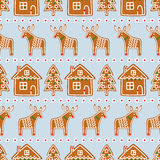 Seamless pattern with Christmas gingerbread cookies - Xmas tree, star, deer, house. Winter holiday vector Xmas design on blue background Stock Photos